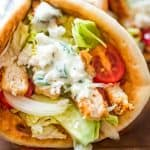 Chicken Gyro topped with tzatziki sauce