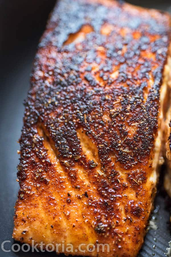searing the salmon on the skillet