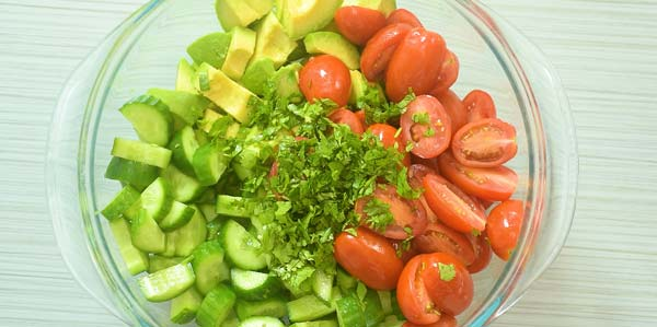 Salad vegetables and cilantro in a bowl