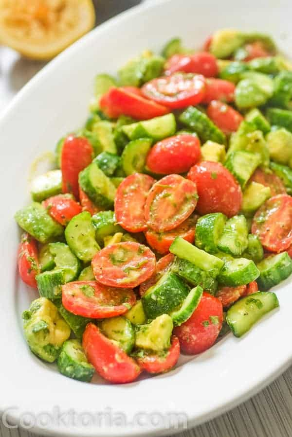 Cucumber Tomato Avocado Salad in a platter
