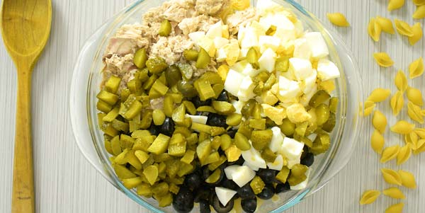 Diced pickles, eggs, and tuna in a bowl