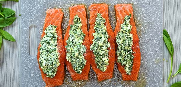 stuffing the salmon with spinach mixture