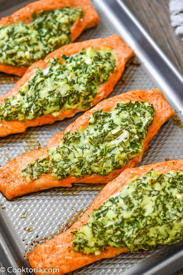Spinach Stuffed Salmon on  a baking sheet
