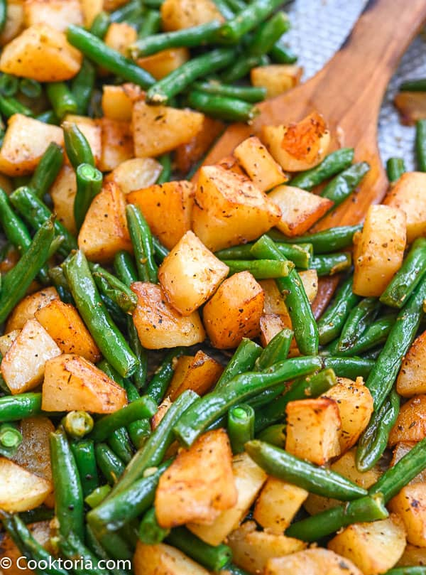 green beans and potatoes on a baking sheet