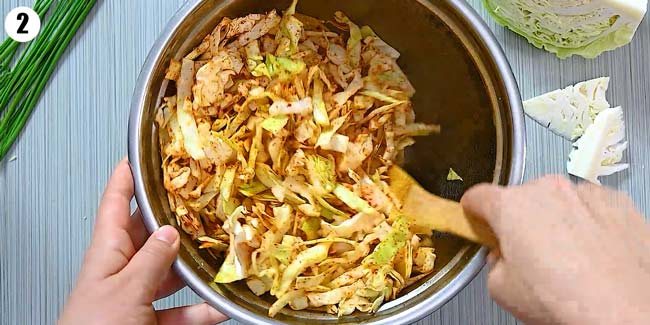mixing the cabbage with spices and butter