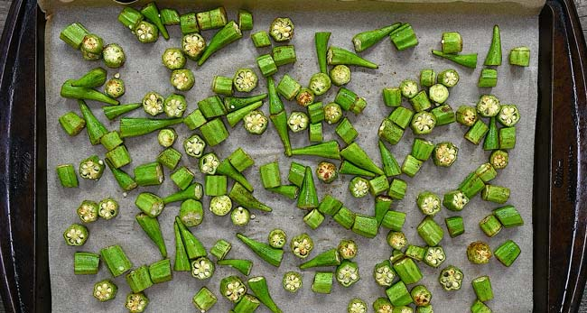 placing okra onto a baking tray