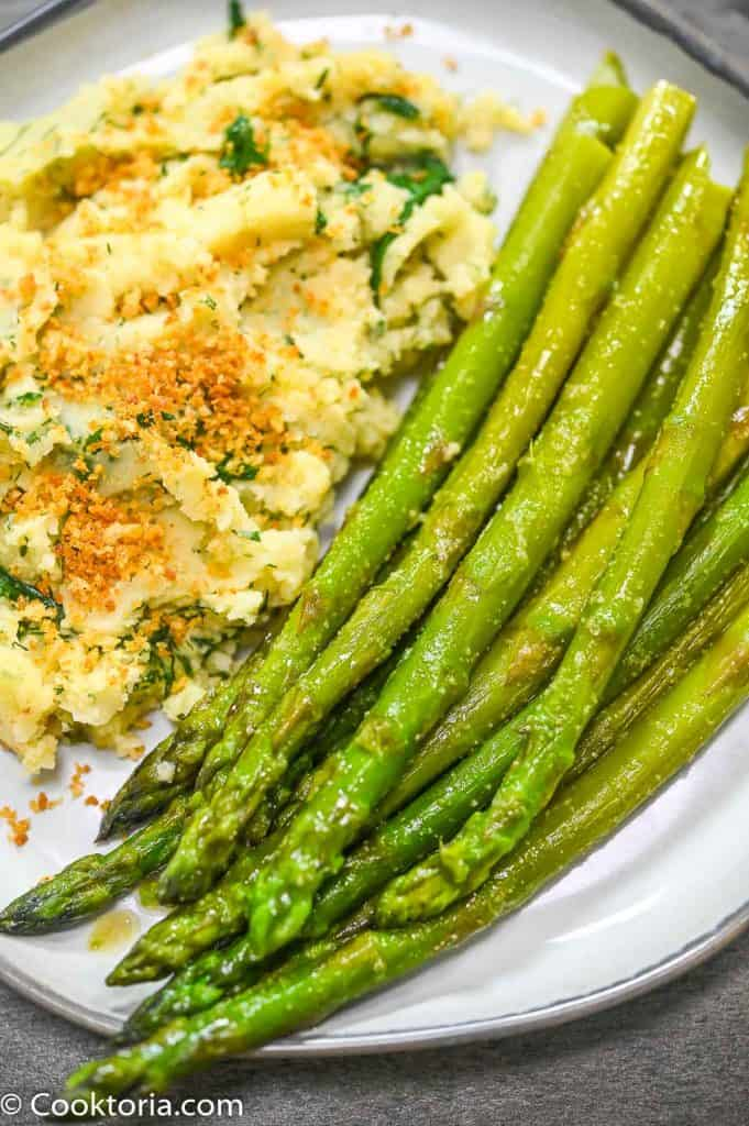 Stovetop Asparagus on a plate with mashed potatoes on the side