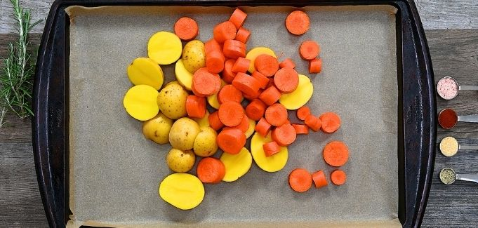 potatoes and carrots on a baking tray